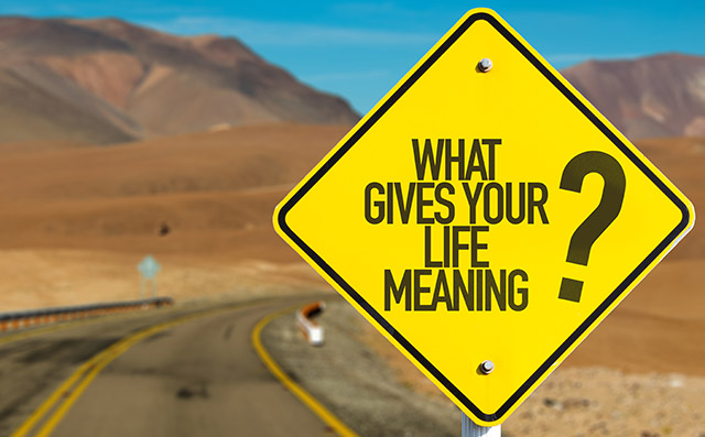 What Gives Your Life Meaning? sign on desert road